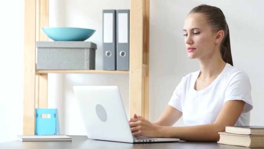 Smiling Woman at Work in Loft Office toward Camera | Shutterstock HD Video #27059656