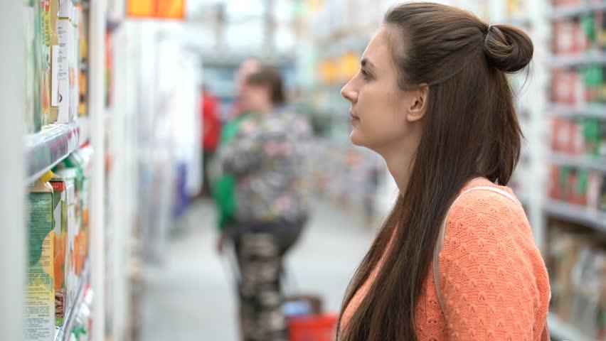 Footage woman buys juice in supermarket. 4k video | Shutterstock HD Video #27076057