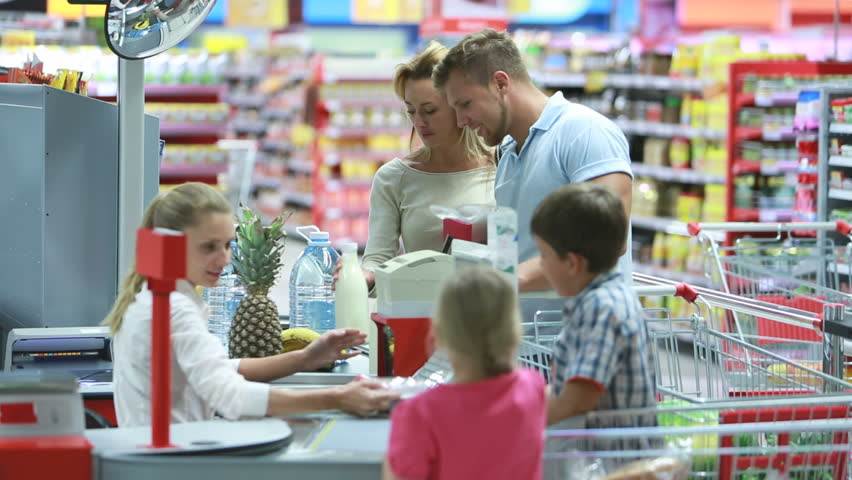 Family paying for groceries at the checkout counter | Shutterstock HD Video #2707757