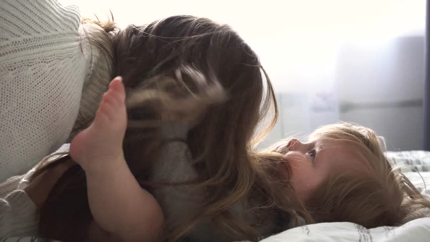 Mother playing with baby girl in bedroom | Shutterstock HD Video #27083257