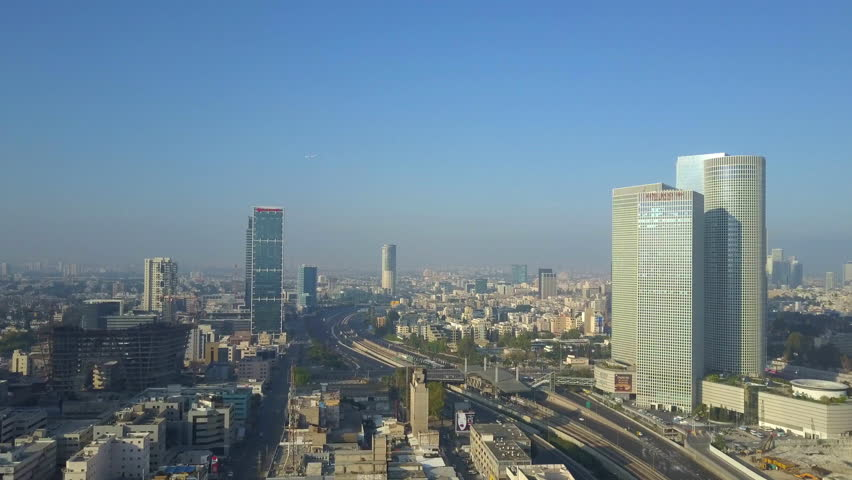 Tel Aviv, Israel - May 13, 2017: Aerial footage of Tel Aviv's skyline along the city's business district with ayalon freeway and skyscrapers.   Shutterstock HD Video #27085987