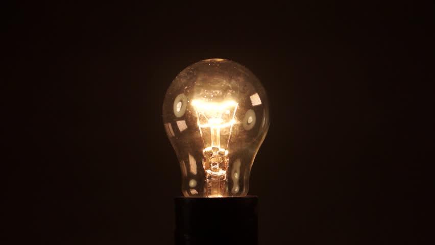 Light bulb on black background. Idea light bulb. electrical disturbances | Shutterstock HD Video #27088387