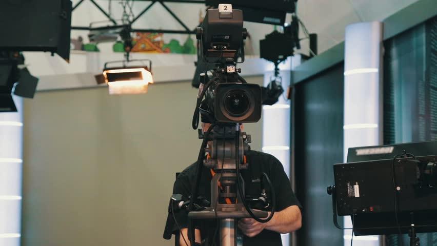 TV operator install video camera for shooting   Shutterstock HD Video #27105031