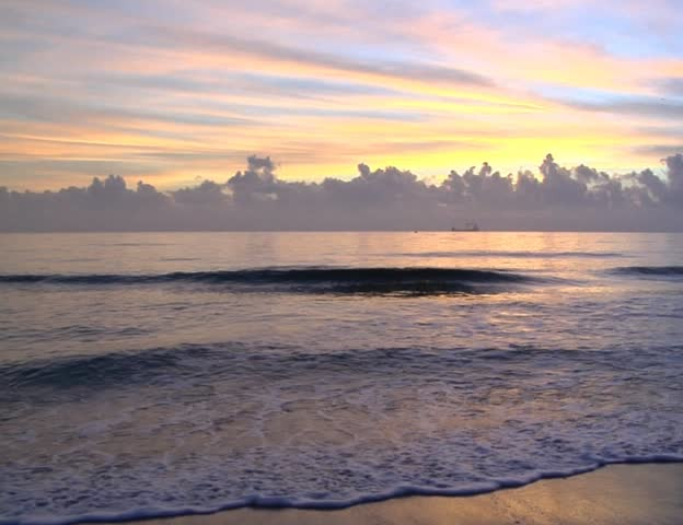 The sunset over the serene ocean PAL video - SD stock footage clip