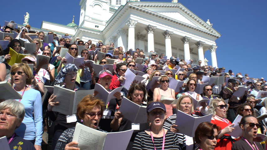 HELSINKI, FINLAND - MAY 19, 2017: Huge choir singing on the steps of the Cathedral. Rehearsal for the big choir at the Senate square on the eve of the church music festival Sana soi Stadissa .