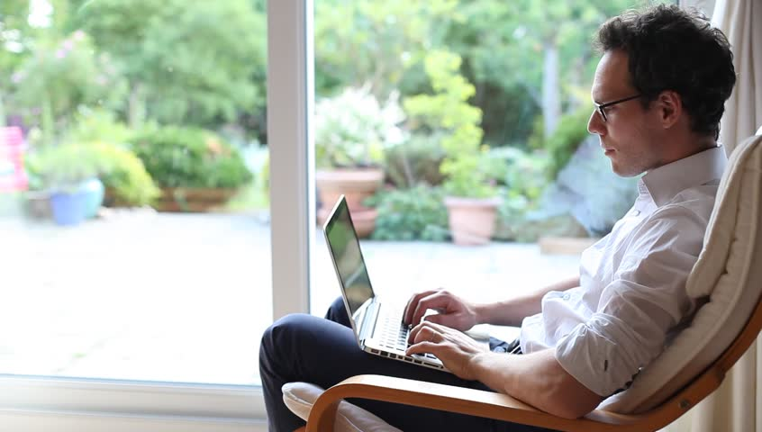 Businessman working on computer at home, telecommuting concept | Shutterstock HD Video #27149152