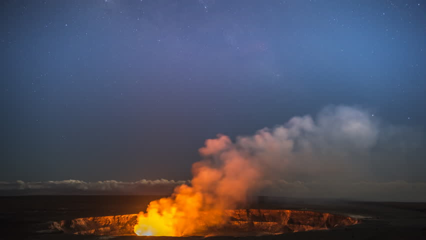 A time lapse captures the glowing lava lake in the caldera of Hawaii's Kilauea Volcano as it bounces light off of the haze drifting by in the sky.