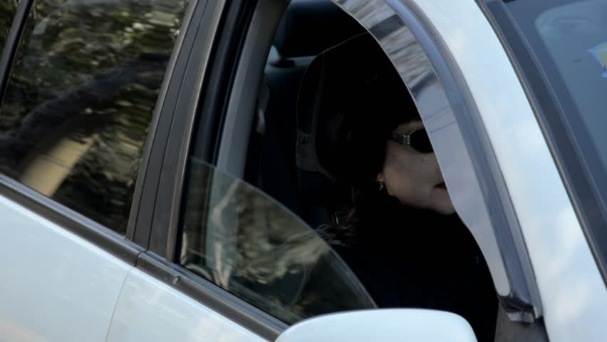 Wish the car window had never opened that pale face of woman in black