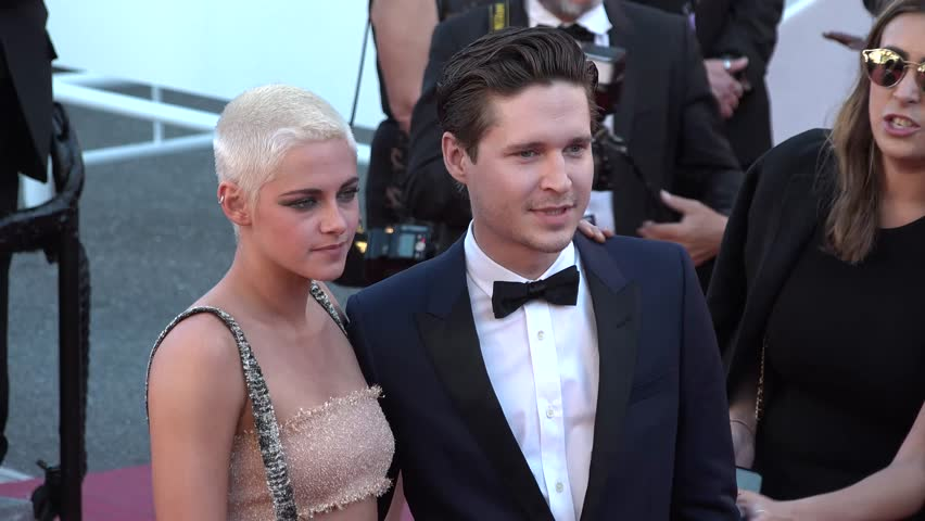 Kristen Stewart with date on the red carpet at the Cannes Film Festival, 5/20/2017