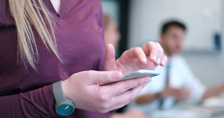 Elegant Woman Using Mobile Phone in office building  | Shutterstock HD Video #27172267