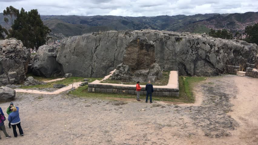 CUZCO, PERU -APR 12, 2017: Tourists at Monoliths in Qenko, an archaeological site in the Sacred Valley, Cusco, Peru. It is one of the largest holy places in the Cusco Region.