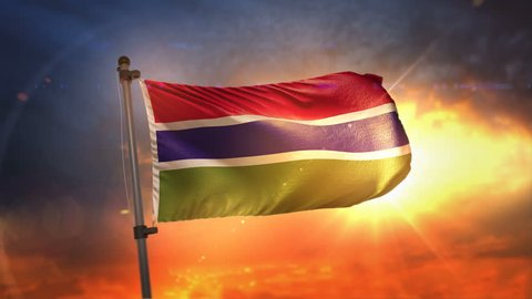 The Gambia Flag Backlit At Beautiful Sunrise Loop Slow Motion 4K