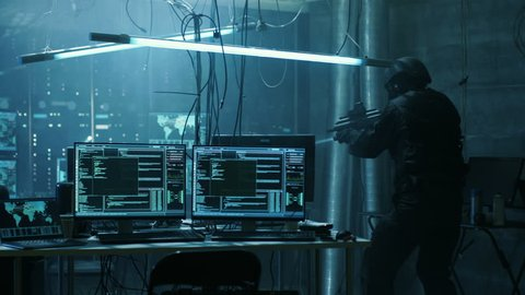 Special Forces Armed Soldier Searches Hacker's Secret Hideout, He's Ready To Shoot. He Searches the Place and Sees Multiple Working Displays, Cables. Shot on RED EPIC-W 8K Helium Cinema Camera.