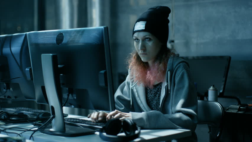 Nonconformist Teenage Hacker Girl Attacks Corporate Servers with Virus with Her Team. Room is Dark, Neon and Has Many Displays and Cables. Shot on RED EPIC-W 8K Helium Cinema Camera. | Shutterstock HD Video #27247417