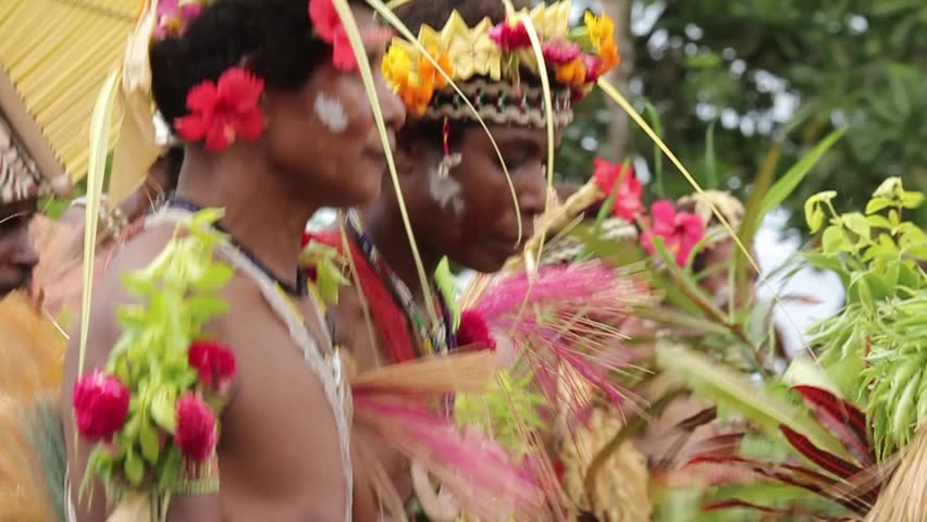 TAMI ISLANDS, PAPUA NEW GUINEA - APRIL 9: Elaborate boat shaped headdresses, flowers, leaves and shells adorn traditional dancers on April 9, 2011 at Tami Island, Papua New Guinea.