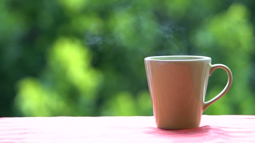 Cup of hot coffee or tea at window side abstract blur background | Shutterstock HD Video #27282007