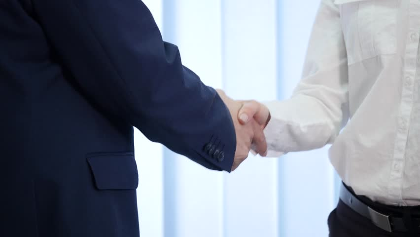 Two business partner shake hands when meeting. In slow motion. | Shutterstock HD Video #27351757