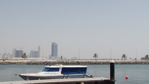SHARJAH, UAE - CIRCA 2008: Pan-left shot of a docked dhow. The dhow was originally used as a trading vessel to transport merchandise along the coast of Eastern Arabia East Africa and South Asia.