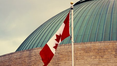 Canadian Flag Waving in Front of Museum in Gatineau