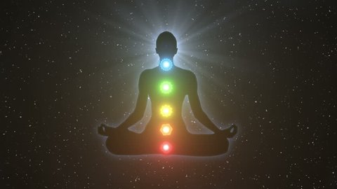 Silhouette of a person sitting in lotus yoga pose achieving nirvana or enlightenment | Unlocking Seven Chakras gaining Spiritual Awakening