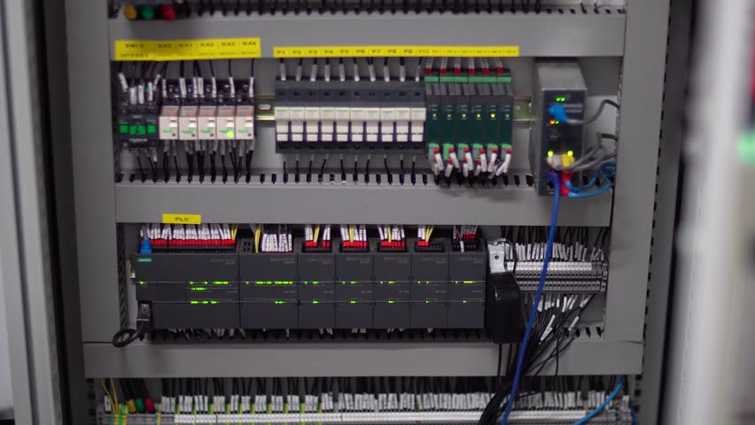 wiring and electrical cabinet in industrial machine  lights blinking to  indicate status of connection and status in communications and electric  supply rack
