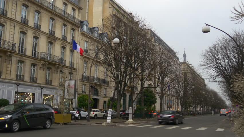PARIS, FRANCE - JANUARY 2017: rainy day famous luxury stores traffic street panorama 4k circa january 2017 paris, france.