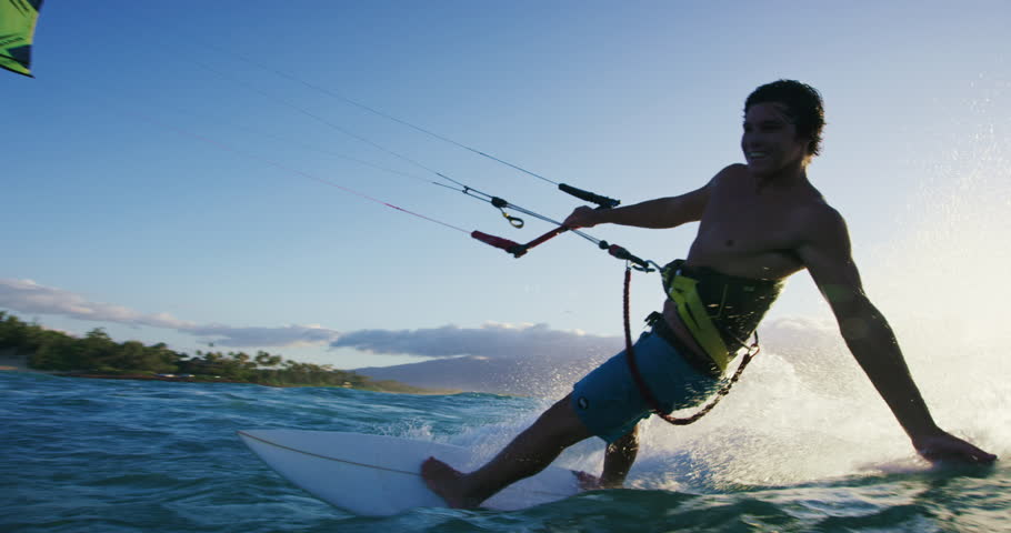 Young man kite surfing. Extreme kite boarding in slow motion. Summer fun action sports. Happiness in nature. Shot on RED | Shutterstock HD Video #27427807