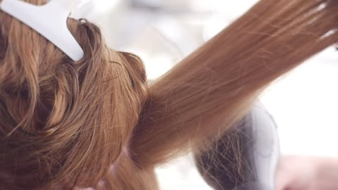 Professional Drying Technique, Slow Motion. the Top is Clipped Up. Dryer Aims Hair Ends, Close Up. Salon Hair Treatment by Hairdresser of High Qualification. Best Blow-Drying Technique, Salon-Level