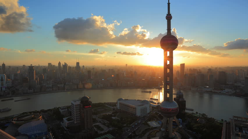 China, Shanghai Skyline at Sunset. Oriental Pearl Tower and Huangpu River.  >>> Please search more similar: