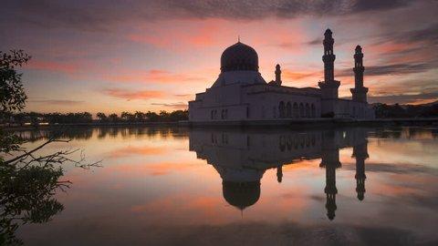 Time lapse of Sunrise and Scattered Clouds at Likas Mosque (Masjid Bandaraya Likas), Kota Kinabalu, Sabah, Malaysia. 4K resolution, ProRes.