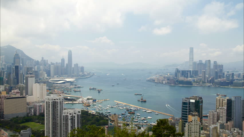 Hong Kong Harbor panorama cityscape - Central District, Victoria Harbor, Victoria Peak, Hong Kong Island and Kowloon, Hong Kong.