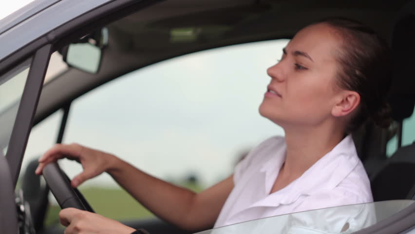 Frustrated young woman stuck in a traffic jam