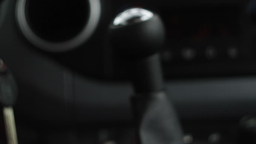 Close up of hand on manual gear shift knob | Shutterstock HD Video #2745344