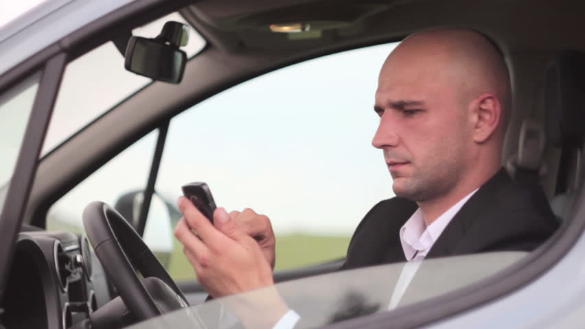 Young handsome businessman using mobile phone in the car | Shutterstock HD Video #2745347