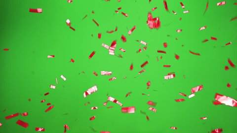 Real Confetti falling soft and beautiful in red and with Green screen for party and celebrations like victories and birthdays or advertising