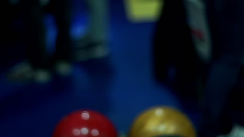 Bowling balls at bowl lift. Multicolor bowling balls close up. Bowling alley lane with balls return machine slow motion