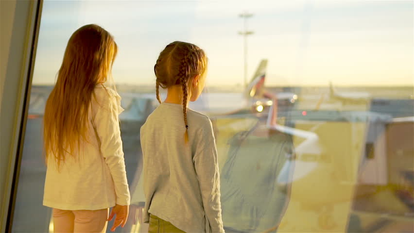 Little kids together in airport waiting for boarding near big window | Shutterstock HD Video #27532657