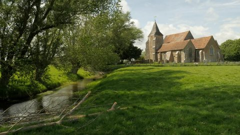 Beautiful old English Country side Church. Medieval Church by water. St. Clements, Old Romney, Romney Marsh.