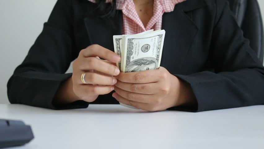 Close up shot hands of woman counting dollar bill banknote #27537787