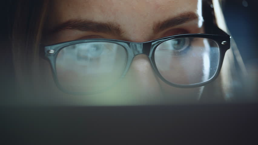 Closeup of woman eyes looking at monitor using modern computer touchscreen, confident businesswoman working at night in modern office with panoramic view browsing the internet | Shutterstock HD Video #27590047