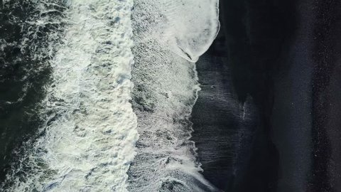 Epic (4K) Drone/Aerial footage of waves breaking against an Icelandic black sand beach, known as Vík í Mýrdal. One of the most beautiful and wettest beaches in the world, created from black basalts.