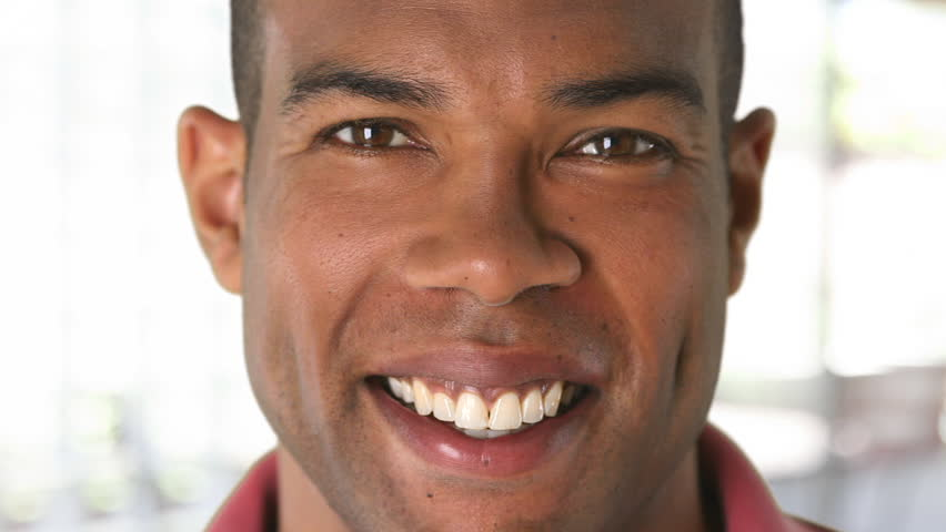 Closeup portrait of smiling African American man's face