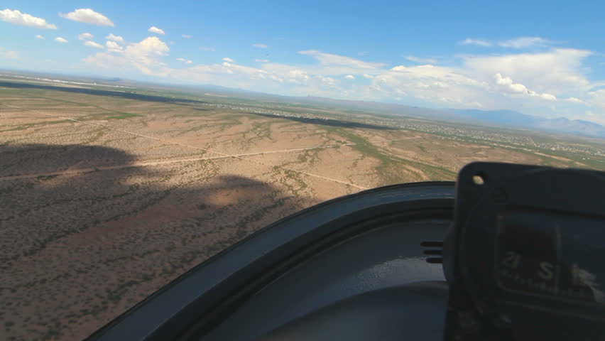 Time Lapse, Glider plane, aerial passenger POV, swoops in for a smooth landing. 1080p