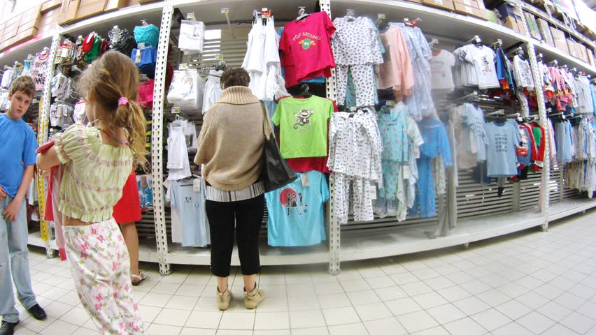 MOSCOW - JUN 15: (Timelapse View) Women go along racks with children t-shirts and pyjamas in Ashan hypermarket, on Jun 15, 2012 in Moscow.Auchan chain plans to launch its first Auchan Drive outlet in Moscow next year.