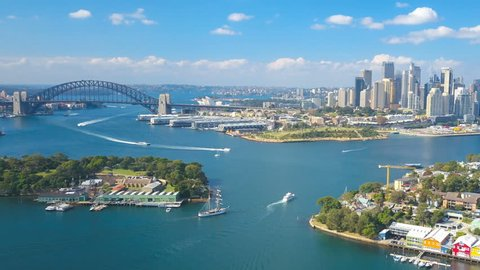 Aerial hyperlapse video of Sydney Harbour, with view of Harbour Bridge, Opera House and skyline of CBD