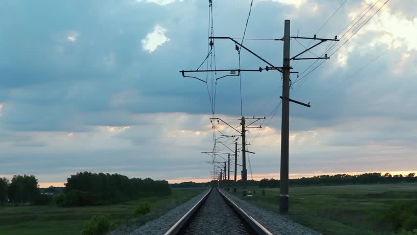 High-voltage networks over the railway track in the field   Shutterstock HD Video #27673657