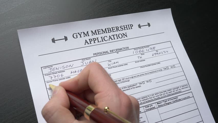 A person filling a gym membership form. Closeup shot.