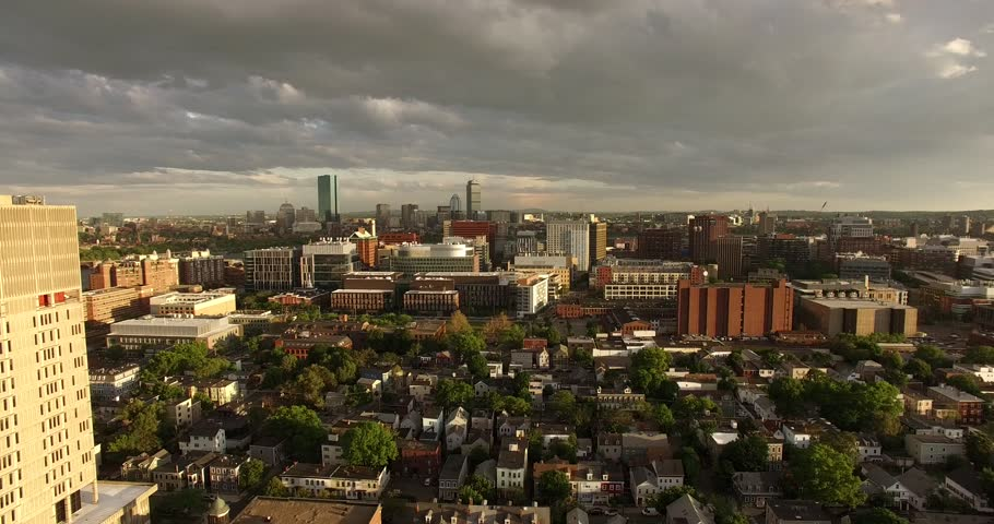 Aerial shot looking over Kendall Square and Boston Skyline in the background