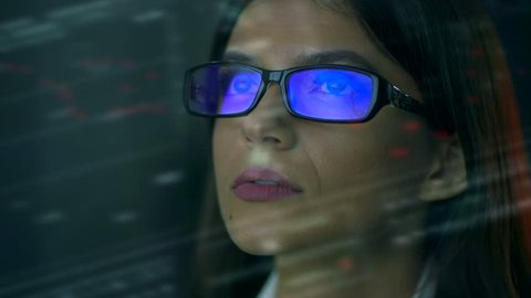 The businesswoman with a glasses over the glass