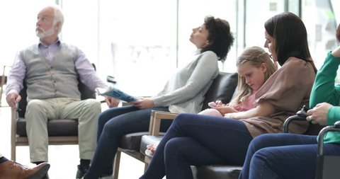 Patients waiting in a crowded hospital waiting room